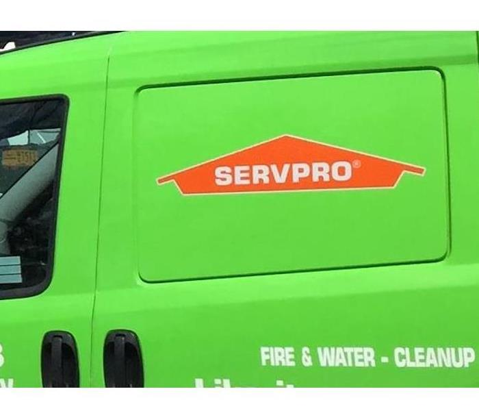 A green SERVPRO vehicle.